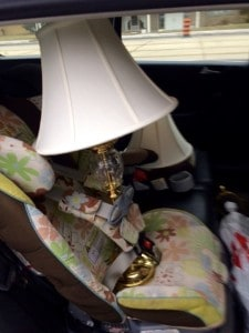 Lamp meets baby seat -- all in a day's work of delivering items to our storage locker.