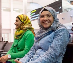 Syrian refugee siblings Rama, right, Riem, and Raniem take a rest at the Toronto Pearson International Airport after arriving from Frankfurt, Germany on Thursday, Dec. 10, 2015. Photo by Hannah Yoon