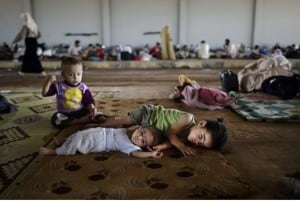 Syrian children rest at the mosque.