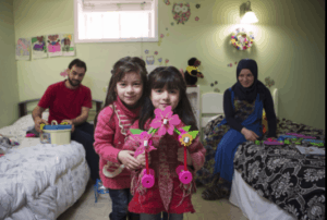 Recent Syrian newcomers: Amir Al Tabouli; his wife, Raghda Altellawi; and daughters, Ghena, 6, and Nagham, 5. The family in the children's bedroom. JENNIFER ROBERTS/For the Washington Post